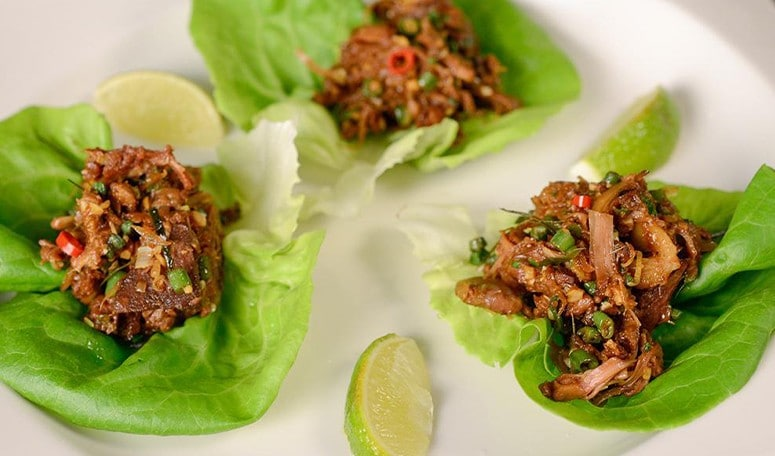 A delicious plate of Jackfruit larb in lettuce cups.